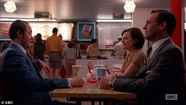 Satisfied Mad Men principle characters seated around a 'Burger Chef' table